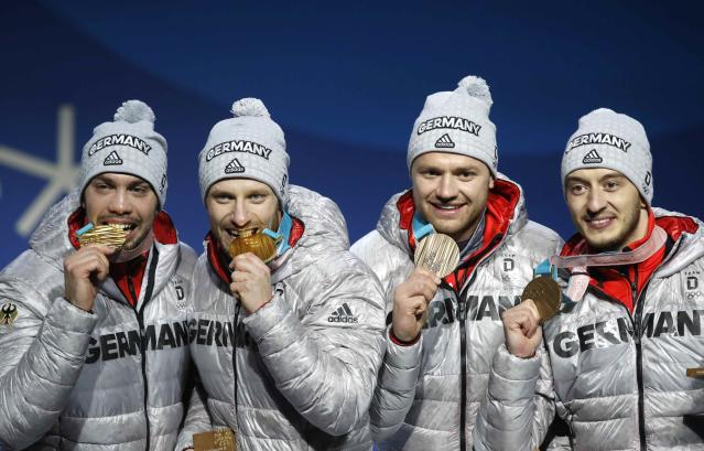 Medals Ceremony - Luge - Pyeongchang 2018 Winter Olympics - Men's Doubles - Medals Plaza - Pyeongchang, South Korea - February 16, 2018 - Gold medalists Tobias Wendl and Tobias Arlt of Germany and bronze medalists, Toni Eggert and Sascha Benecken of Germany on the podium. REUTERS/Kim Hong-Ji