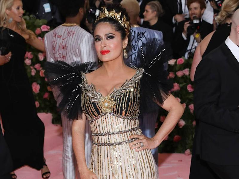 Salma Hayek can't get enough of sparkly headpieces