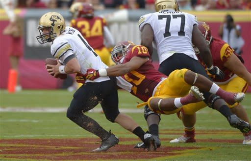 Colorado quarterback Jordan Webb, left, is sacked by Southern California linebacker Hayes Pullard during the first half of an NCAA college football game, Saturday, Oct. 20, 2012, in Los Angeles. (AP Photo/Mark J. Terrill)
