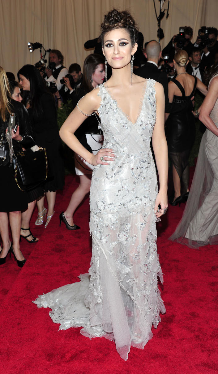 """Emmy Rossum attends The Metropolitan Museum of Art's Costume Institute benefit celebrating """"PUNK: Chaos to Couture"""" on Monday May 6, 2013 in New York. (Photo by Charles Sykes/Invision/AP)"""