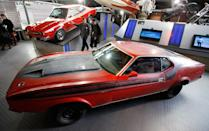"Visitors walk past a Ford Mustang Mach 1 from the James Bond Film ""Diamonds are Forever"" at the opening of the ""Bond in Motion: 50 Vehicles 50 Years"" exhibition at the National Motor Museum in Beaulieu, southern England January 15, 2012. REUTERS/Suzanne Plunkett"