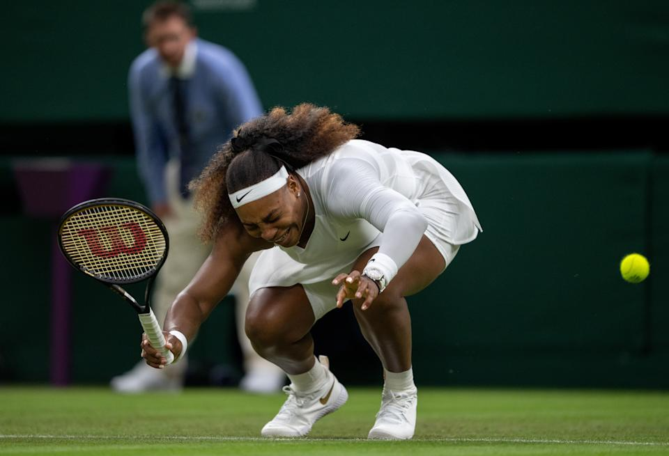LONDON, ENGLAND - JUNE 29: Serena Williams of The United States reacts as she winces in pain in her Ladies' Singles First Round match against Aliaksandra Sasnovich of Belarus during Day Two of The Championships - Wimbledon 2021 at All England Lawn Tennis and Croquet Club on June 29, 2021 in London, England. (Photo by AELTC/Jed Leicester - Pool/Getty Images)
