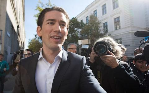Austria's Foreign Minister and leader of Austria's centre-right People's Party (OeVP) Sebastian Kurz leaves a polling station during general elections in Vienna - Credit: AFP