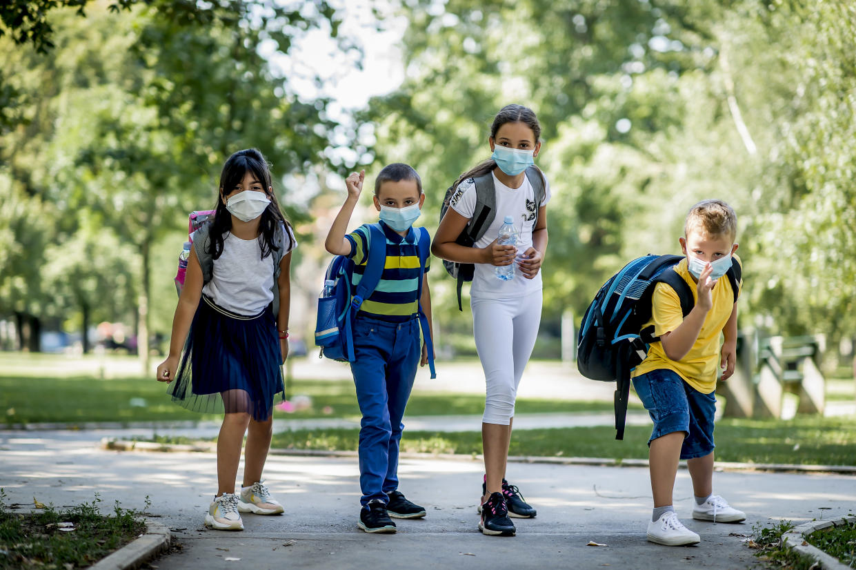 Children going back to school after epidemic, They are wearing a protective face mask