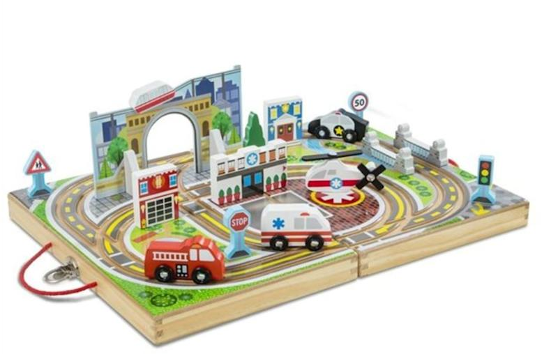 "Built-in tracks, colourful scenery, and fun play pieces.&nbsp;<strong>Ages:</strong> 3+&nbsp;<strong>Get it at: </strong><a href=""https://www.chapters.indigo.ca/en-ca/toys/melissa-doug-take-along-tabletop/000772301411-item.html"" target=""_blank"" rel=""noopener noreferrer"">Indigo</a>, $39.99"