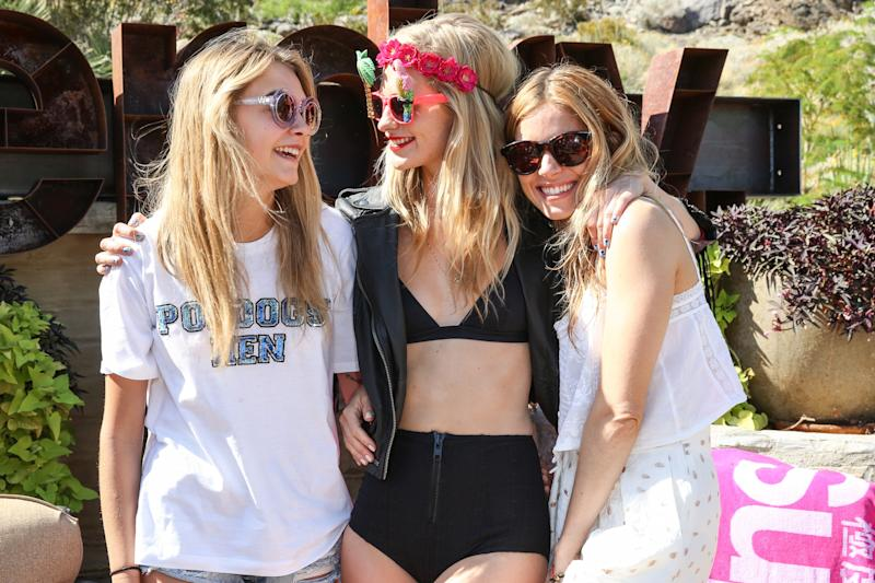 Cara and Poppy Delevingne and Sienna Miller attend the Coachella Music Festival in Indio, California.