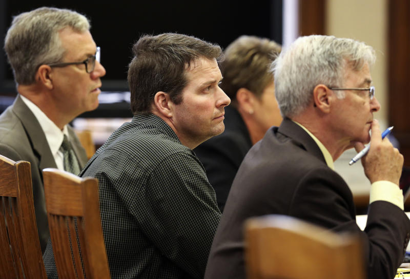 Todd Mullis, center, attends his first-degree murder trial at Dubuque County Courthouse in Dubuque, Iowa, on Tuesday, Sept. 17, 2019. Mullis is accused of killing Amy L. Mullis by stabbing her with a corn rake on Nov. 10.  (Nicki Kohl/Telegraph Herald via AP)