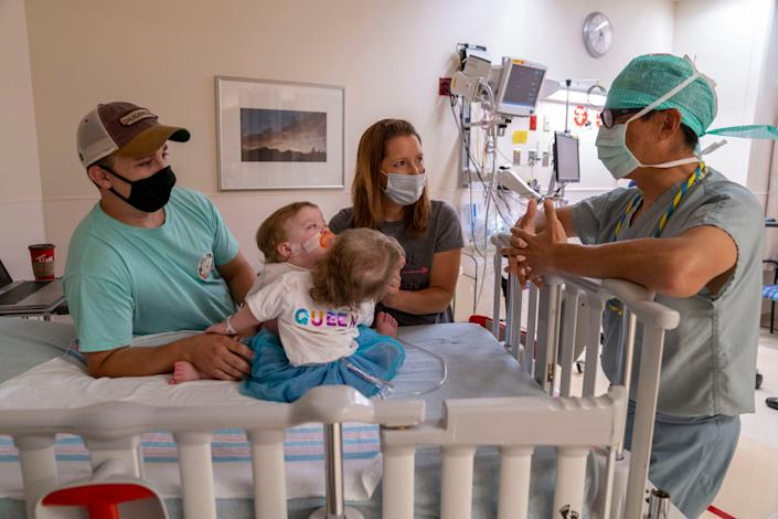 Dr. Richard Ohye, M.D., lead cardiac surgeon, talks to Phil and Alyson Irwin on the morning of surgery.