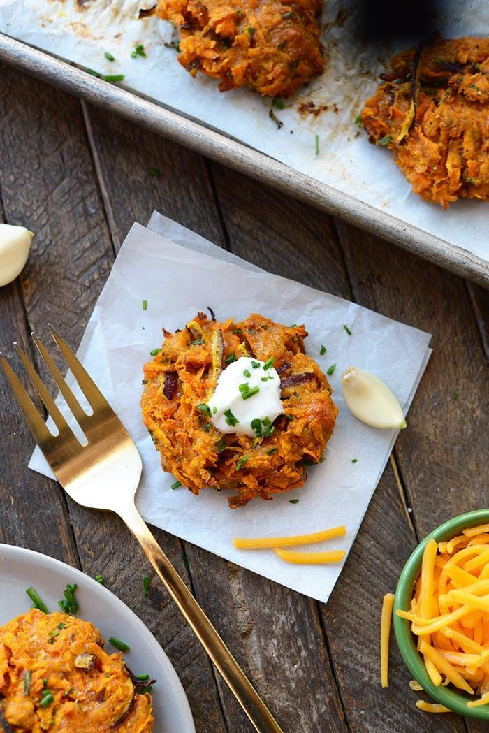 """<p>Made with a base of grated sweet potatoes, sharp cheddar cheese, and an alluring blend of spices, you might have to make an extra batch of these potato fritters for good measure. Pair these with an ice-cold beer, and you'll wish it was the Super Bowl every Sunday.</p> <p><strong>Get the recipe:</strong> <a href=""""https://fitfoodiefinds.com/2016/11/video-baked-cheddar-sweet-potato-fritters/"""" class=""""link rapid-noclick-resp"""" rel=""""nofollow noopener"""" target=""""_blank"""" data-ylk=""""slk:baked cheddar sweet potato fritters"""">baked cheddar sweet potato fritters</a></p>"""
