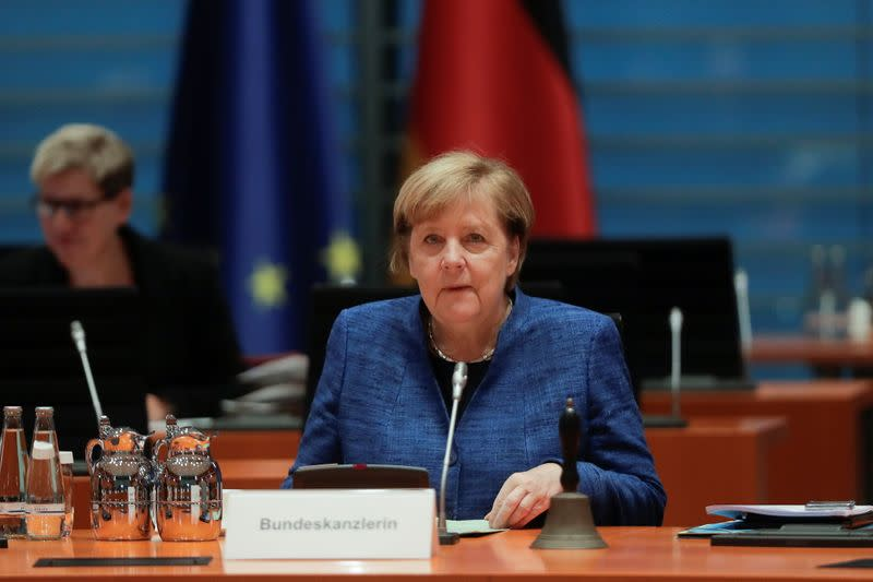 FILE PHOTO: German Chancellor Angela Merkel attends the weekly cabinet meeting of the government at the chancellery in Berlin