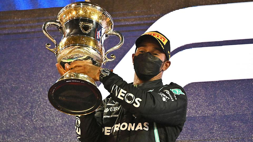 Seen here, Lewis Hamilton holds the trophy after winning the Bahrain GP.