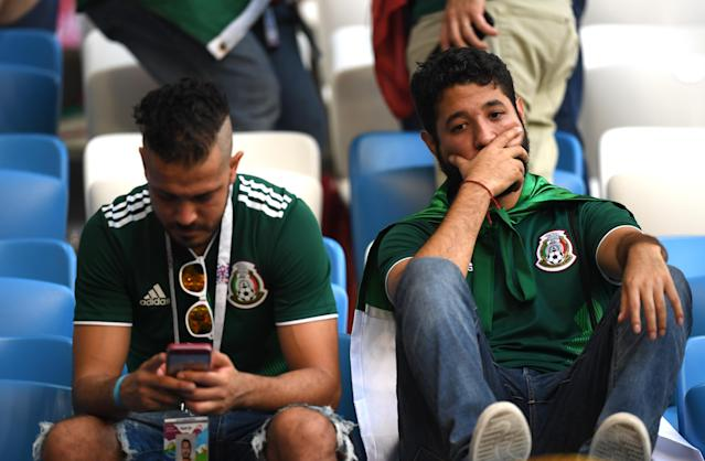 <p>Mexico fans look dejected following their sides defeat in the 2018 FIFA World Cup Russia Round of 16 match between Brazil and Mexico at Samara Arena on July 2, 2018 in Samara, Russia. (Photo by Matthias Hangst/Getty Images) </p>