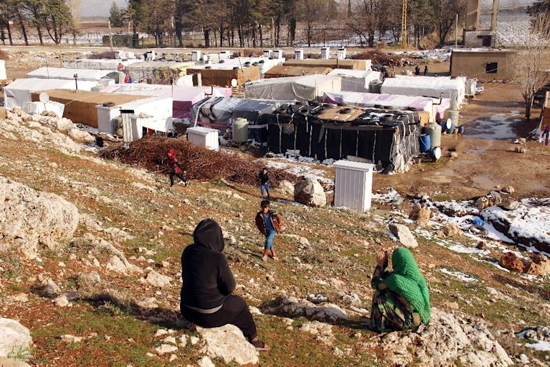 Syrian refugees at an unofficial refugee camp in Bar Elias, in Lebanon's Bekaa Valley, on January 26, 2016 (AFP Photo/Hassan Jarrah)