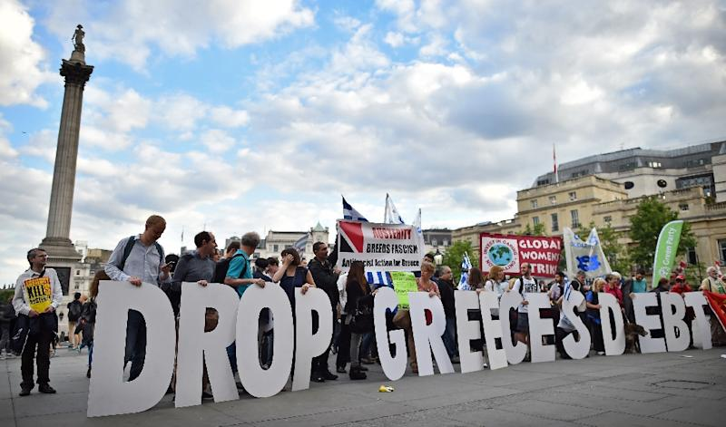 Demonstrators gather to show their solidarity with the people of Greece, near Nelson's Column in central London, on June 23, 2015 (AFP Photo/Ben Stansall)