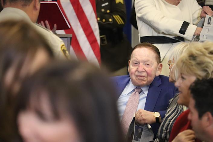 Las Vegas Sands casino magnate Sheldon Adelson next to his wife, Miriam, at Las Vegas Metropolitan Police Department headquarters to watch President Donald Trump deliver remarks at a Hope for Prisoners graduation ceremony.