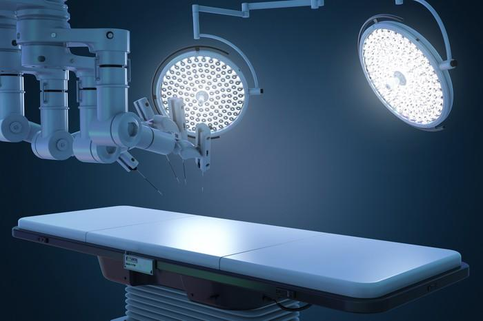 Surgical table with surgical robot by it