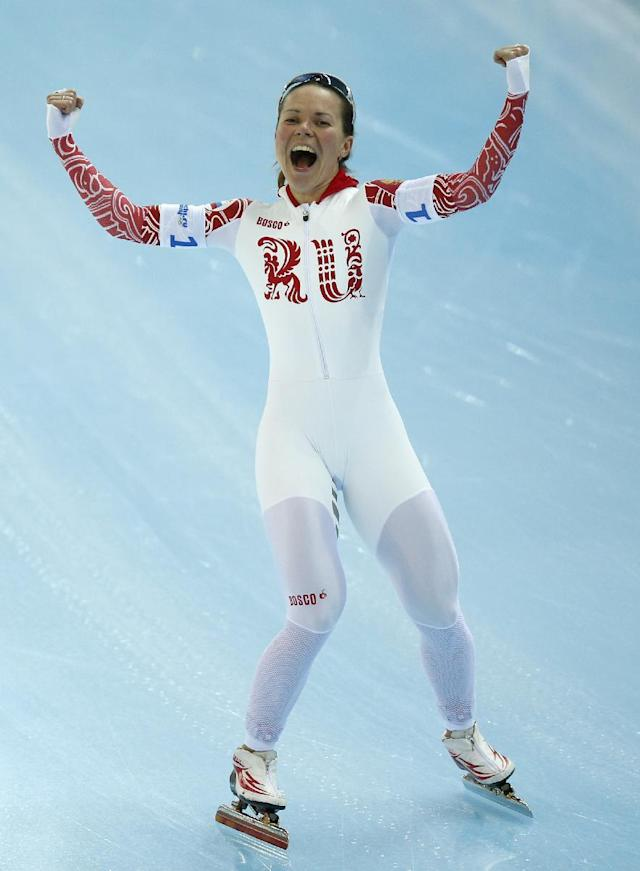 Olga Graf of Russia celebrates after competing in the women's speedskating team pursuit quarterfinals at the Adler Arena Skating Center during the 2014 Winter Olympics in Sochi, Russia, Friday, Feb. 21, 2014. (AP Photo/Pavel Golovkin)