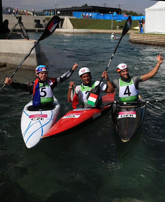 LONDON, ENGLAND - AUGUST 01: Daniele Molmenti (C) of Italy celebrates winning the gold medal with silver medalist Vavrinec Hradilek of Czech Republic and bronze medalist Hannes Aigner of Germany after the Men's Kayak Single (K1) Final on Day 5 of the London 2012 Olympic Games at Lee Valley White Water Centre on August 1, 2012 in London, England. (Photo by Phil Walter/Getty Images)