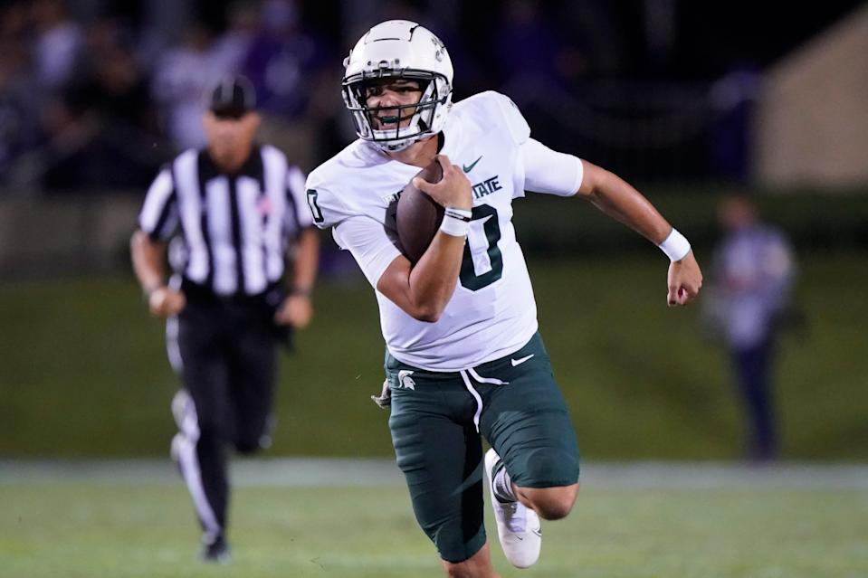 Michigan State quarterback Payton Thorne runs with the ball during the first half of an NCAA college football game against Northwestern in Evanston, Ill., Friday, Sept. 3, 2021.