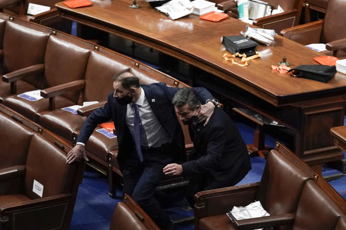 Lawmakers evacuate the floor as protesters try to break into the House Chamber at the U.S. Capitol on Wednesday, Jan. 6, 2021, in Washington. (AP Photo/J. Scott Applewhite)