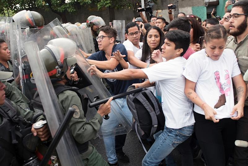 Street protests erupted for a second day in Caracas as students marched on the Supreme Court, where they scuffled with soldiers (AFP Photo/STR)