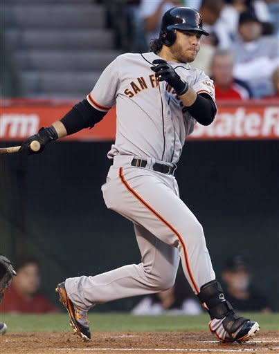 San Francisco Giants' Brandon Crawford watches his two-run triple against the Los Angeles Angels during the second inning of a baseball game in Anaheim, Calif., Monday, June 18, 2012. (AP Photo/Chris Carlson)