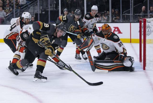 Vegas Golden Knights right wing Reilly Smith (19) tries for a shot on Anaheim Ducks goaltender Ryan Miller (30) during the second period of an NHL hockey game Wednesday, Nov. 14, 2018, in Las Vegas. (AP Photo/Eric Jamison)