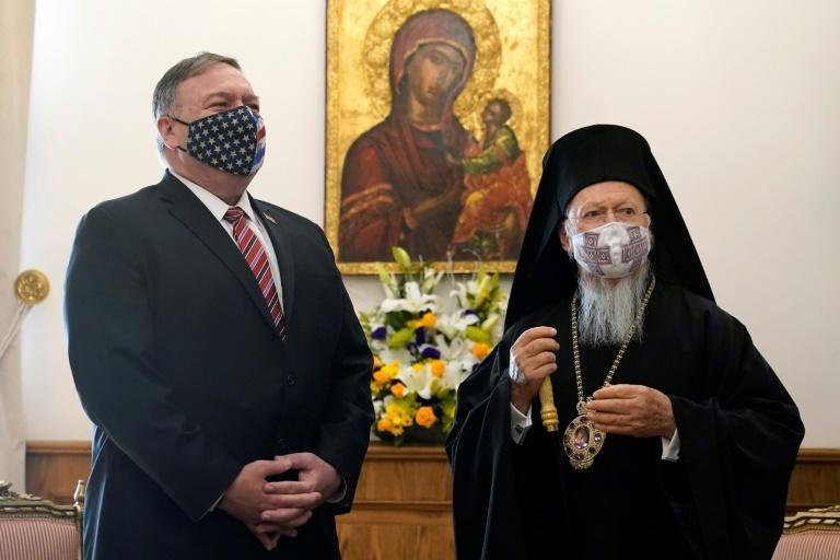 US Secretary of State Mike Pompeo (L) listens to Ecumenical Patriarch Bartholomew I