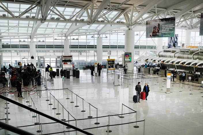 People walk through a nearly empty terminal at John F. Kennedy Airport (JFK) on January 31, 2020 in New York City. 2