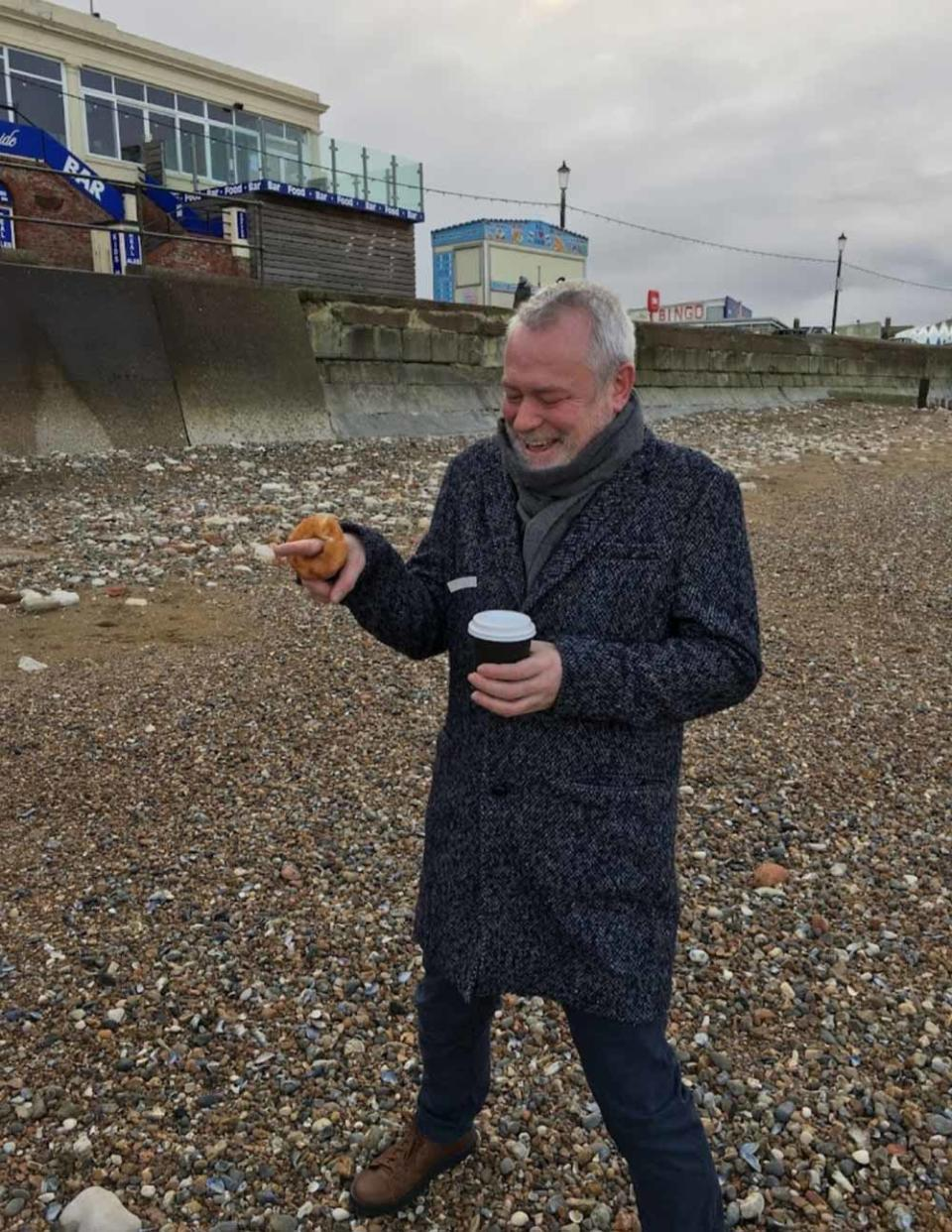 John proposed to Richard with a cinnamon ring doughnut on the beach. (Collect/PA Real Life)