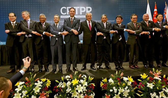 Representatives from the 11 CPTPP member countries mark the signing of the agreement in 2018. Photo: AP