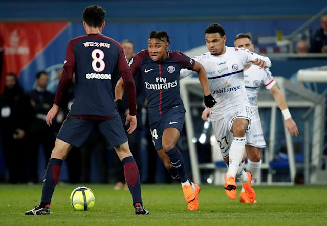Soccer Football - Ligue 1 - Paris St Germain vs RC Strasbourg - Parc des Princes, Paris, France - February 17, 2018 Paris Saint-Germain's Christopher Nkunku in action with Strasbourg's Kenny Lala REUTERS/Benoit Tessier