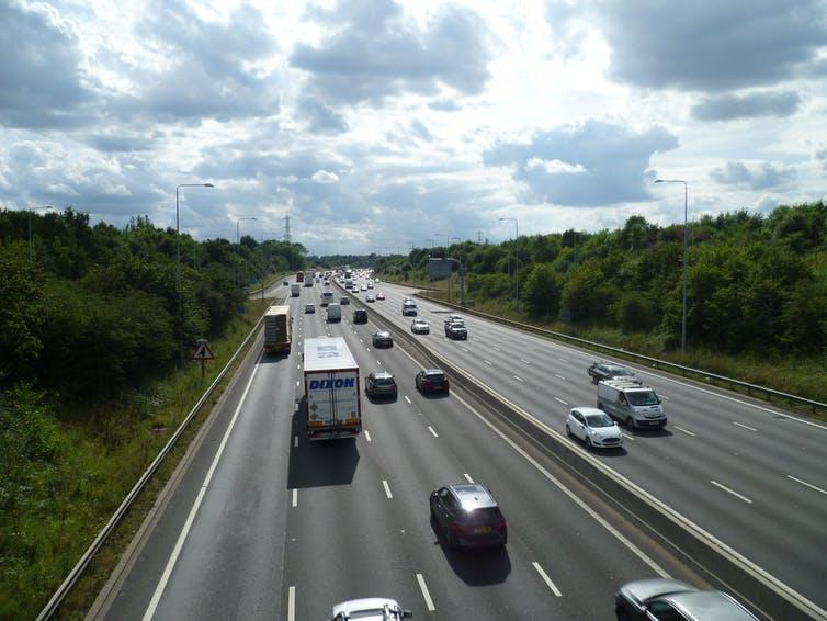 Two four-lane motorways side by side.