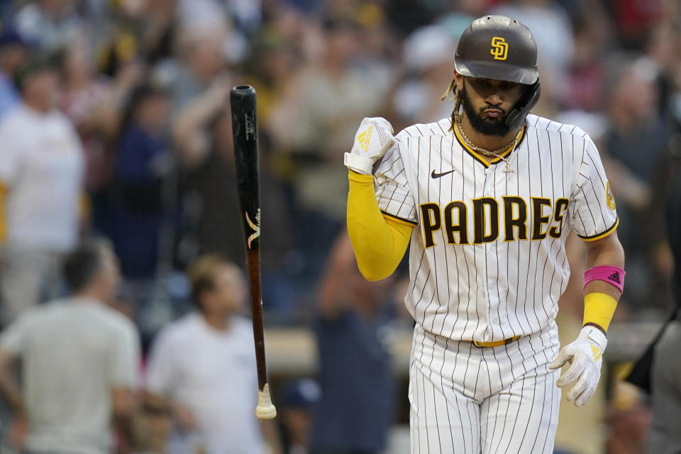San Diego Padres' Fernando Tatis Jr., tosses his bat after hitting a home run during the first inning of a baseball game against the Arizona Diamondbacks, Friday, June 25, 2021, in San Diego. (AP Photo/Gregory Bull)