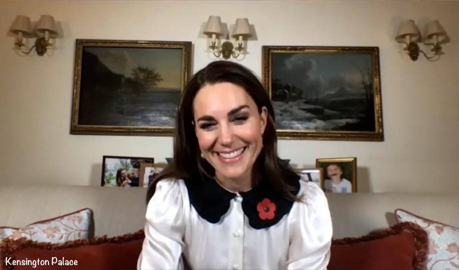 Image of Duchess Kate in video link on Remembrance Day photos of family behind her