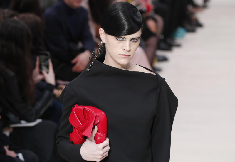 A model wears a creation for the Valentino fashion collection during Women's fashion week Fall/Winter 2020/21 presented in Paris, Sunday, March 1, 2020. (AP Photo/Francois Mori)