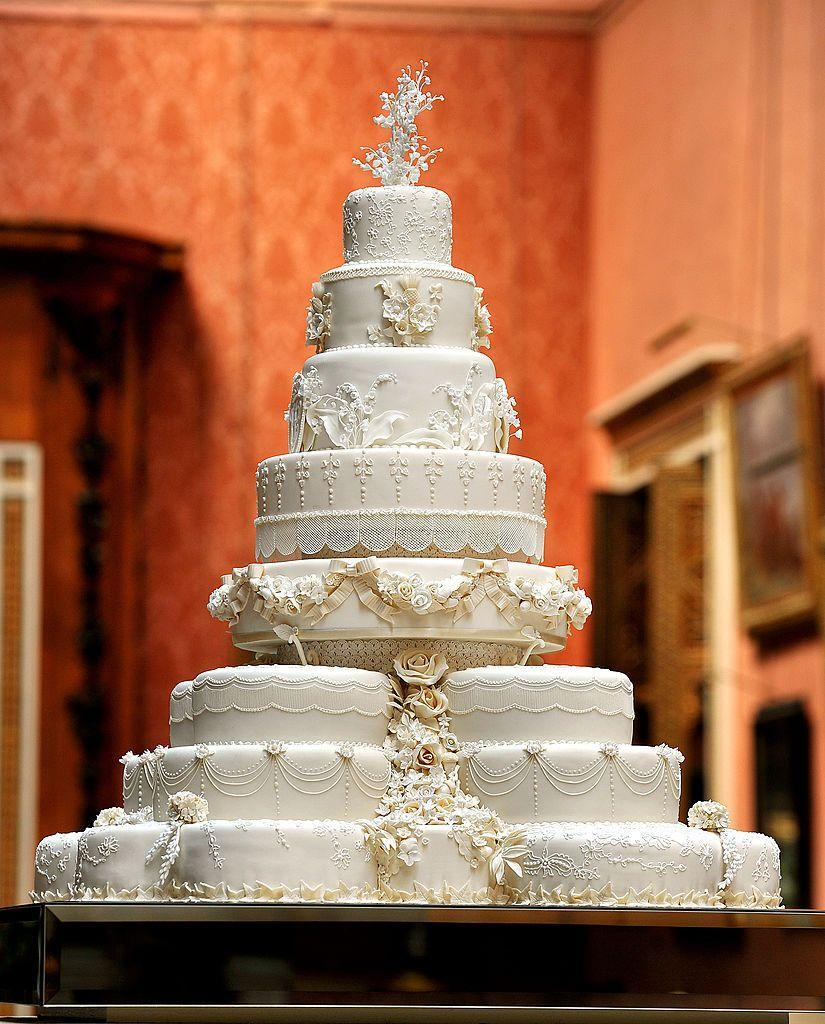"""<p>More than 900 sugar paste flowers were etched onto the royal <a href=""""https://www.elle.com/uk/life-and-culture/a36071909/kate-middleton-prince-william-royal-wedding-cake-queen/"""" rel=""""nofollow noopener"""" target=""""_blank"""" data-ylk=""""slk:couple's cake by designer and baker Fiona Cairns;"""" class=""""link rapid-noclick-resp"""">couple's cake by designer and baker Fiona Cairns; </a>sweet William and myrtle to symbolise love and marriage - just like in Kate's bouquet - were some of the flowers adorned on the cake, as too were blooms replicating the lace design of the bride's wedding dress. </p><p>Layers of the couple's cake were preserved and later used at the christenings of <a href=""""https://www.elle.com/uk/life-and-culture/culture/g33388705/kate-middleton-children/"""" rel=""""nofollow noopener"""" target=""""_blank"""" data-ylk=""""slk:their three children,"""" class=""""link rapid-noclick-resp"""">their three children,</a> Prince George, Princess Charlotte and Prince Louis.</p>"""