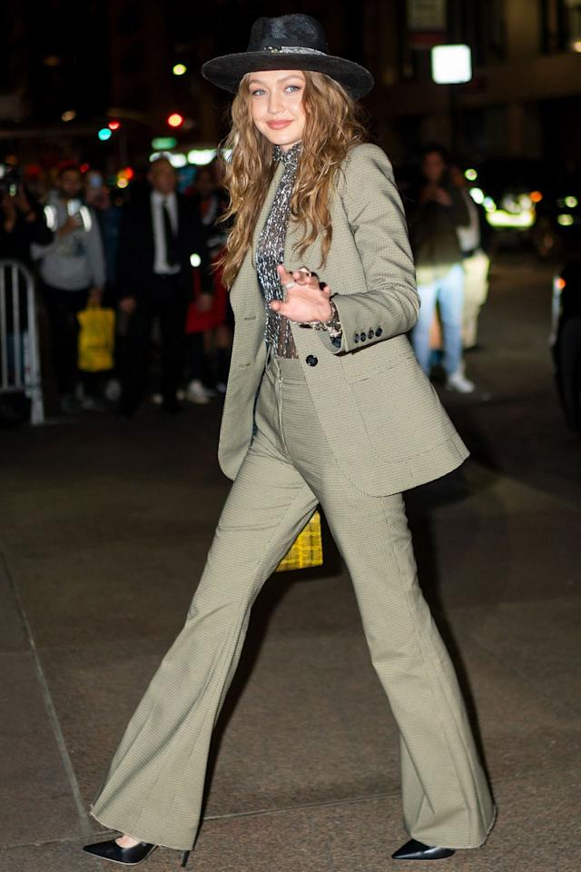 "<p><strong>April 2019</strong> Gigi Hadid wore a green tailored suit to attend <a href=""https://www.harpersbazaar.com/uk/celebrities/news/a27064755/marc-jacobs-char-defrancesco-wedding/"" target=""_blank"">Marc Jacobs' wedding</a> in New York. </p>"