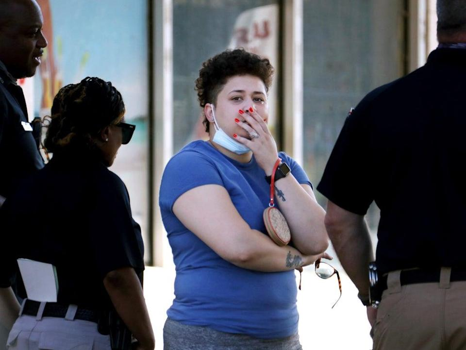 Family members of victims wait with Memphis Police Department officers outside of a post office after a shooting (AP)