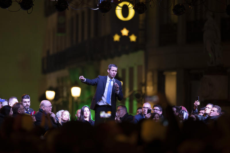 The leader of Venezuela's political opposition Juan Guaido addresses the crowd in the Puerta del Sol square during a visit to Madrid, Spain, Saturday, Jan. 25, 2020. Juan Guaido, the man who one year ago launched a bid to oust Venezuelan President Nicolas Maduro, arrived Saturday in Spain, where a thriving community of Venezuelans and a storm among Spanish political parties awaited him.(AP Photo/Paul White)