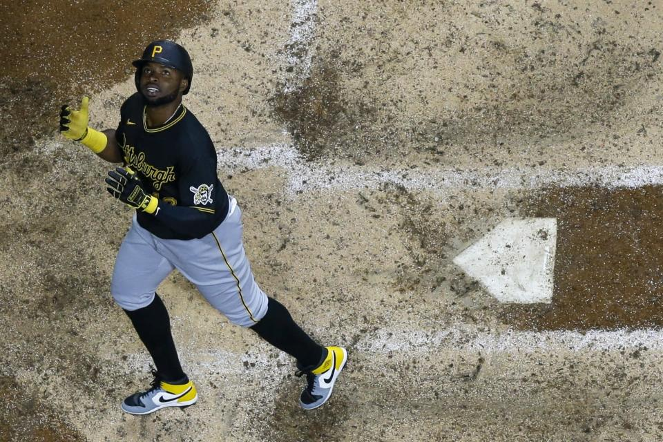 Pittsburgh Pirates' Gregory Polanco looks up as he crosses home after hitting a two-run home run during the eighth inning of a baseball game against the Milwaukee Brewers Friday, April 16, 2021, in Milwaukee. (AP Photo/Morry Gash)