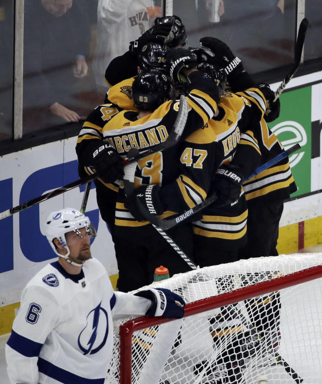 Boston Bruins celebrate a goal by left wing Jake DeBrusk (74) as Tampa Bay Lightning defenseman Anton Stralman (6) stands by the net in the second period of an NHL hockey game, Thursday, Feb. 28, 2019, in Boston. (AP Photo/Elise Amendola)