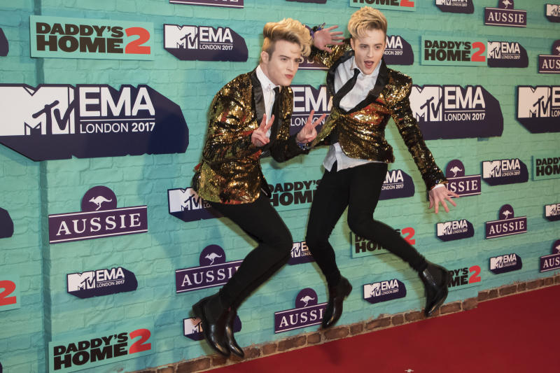 Jedward pose for photographers upon arrival at the MTV European Music Awards 2017 in London, Sunday, Nov. 12th, 2017. (Photo by Vianney Le Caer/Invision/AP)