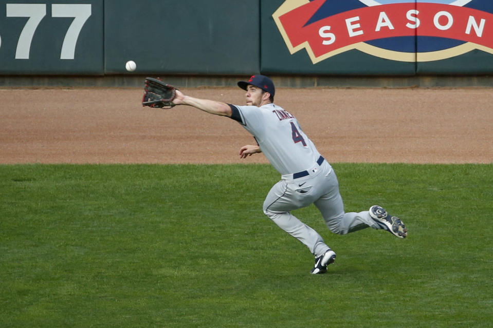 Cleveland Indians center fielder Bradley Zimmer makes a catch of a fly ball hit by Minnesota Twins' Luis Arraez in the fourth inning of a baseball game Saturday, Aug. 1, 2020, in Minneapolis. (AP Photo/Bruce Kluckhohn)