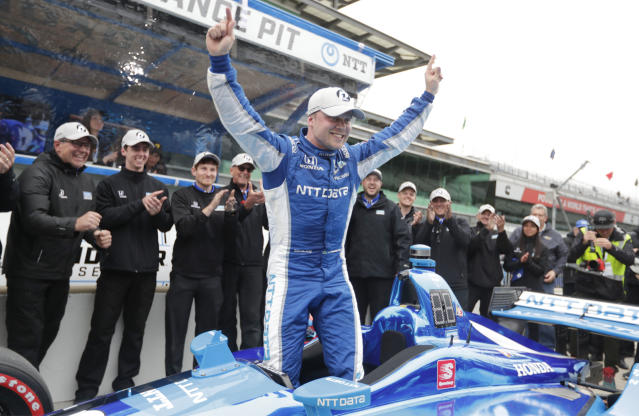 FILE - In this May 10, 2019, file photo, Felix Rosenqvist, of Sweden, celebrates after winning the pole during qualifications for the Indy GP IndyCar auto race at Indianapolis Motor Speedway in Indianapolis. Rosenqvist leads all rookies in the IndyCar series this season with 209 points after finishing sixth with a car that qualified just 18th last weekend at Road America. (AP Photo/Michael Conroy, File)