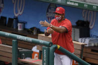 Washington Nationals manager Dave Martinez gestures from the dugout during the fourth inning of the first baseball game of the team's doubleheader against the Miami Marlins, Saturday, Aug. 22, 2020, in Washington. (AP Photo/Nick Wass)