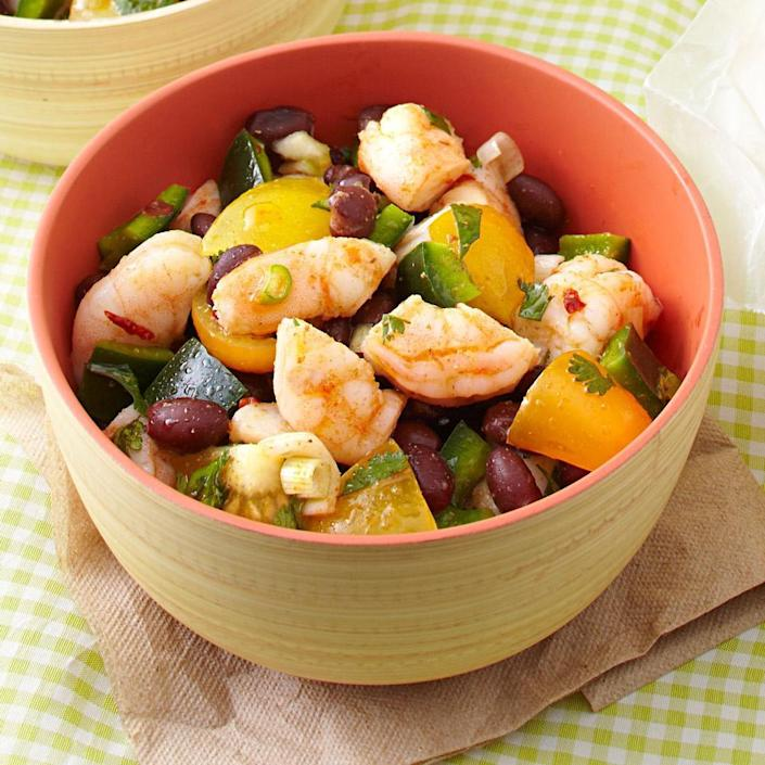 """<p>Loaded with fresh tomatoes, peppers and cilantro and seasoned with cumin and chile, this shrimp and black bean salad recipe has all the flavors of a great fresh salsa and is a quick and easy no-cook recipe. Serve with tortilla chips or fresh corn tortillas.</p> <p> <a href=""""http://www.eatingwell.com/recipe/250522/zesty-shrimp-black-bean-salad/"""" rel=""""nofollow noopener"""" target=""""_blank"""" data-ylk=""""slk:View recipe"""" class=""""link rapid-noclick-resp""""> View recipe </a></p>"""