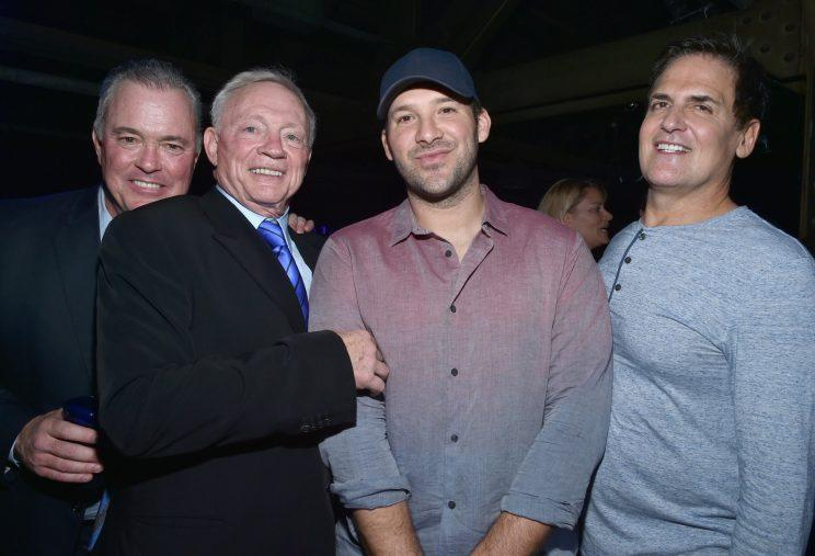 Mark Cuban (R) rubbed elbows with the Cowboys' brain trust, Stephen and Jerry Jones, and QB Tony Romo during Super Bowl week in February. It's unclear if they dined on swine. (Getty Images)