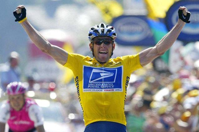 Lance Armstrong celebrating at the 2004 Tour de France. (Getty)
