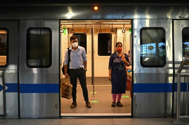 Metro services in India's capital New Delhi have been allowed to operate at 50 percent capacity as the number of new coronavirus infections dropped